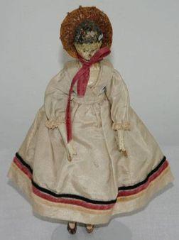 A Victorian peg doll.
